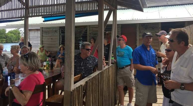 Retire Outside the USA - Expats in Roatan Listening to the Band