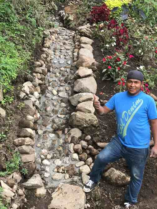 Retire to Boquete - Roger and the stream bed he built.
