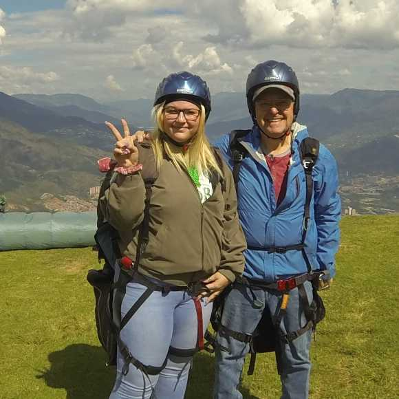 Retire Outside The USA - Haley and Papa prepare to paraglide